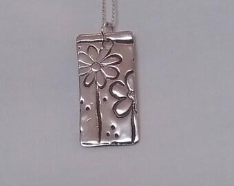 Handmade Fine Silver flower pendant....