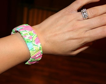 Two fabric bangle style bracelets made with Lilly Pulitzer Fabric.