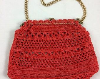 Red 1950s crochet handbag.