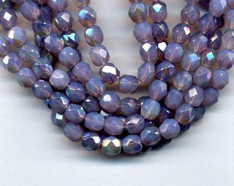 10 6 mm purple iridescent Opal beads