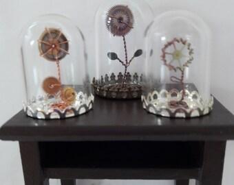 Miniature steampunk flower in glass dome