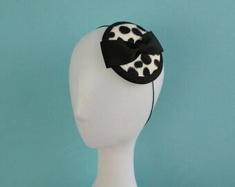 Vintage style Dalmation print faux fur fascinator with black petersham bow.
