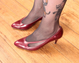 burgundy red leather pumps with cut out design . Caressa, made in Spain, womens size 8 pointy toe heels