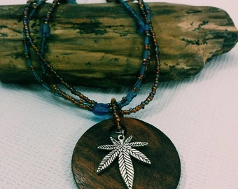 Wooden Disc Cannabis Leaf Necklace.