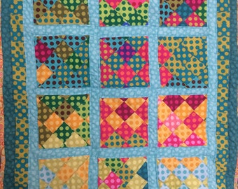 Polka-dot patchwork baby quilt