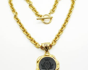 Fendi necklace etsy fendi vintage black crest pendant and gold chain necklace 1990s mozeypictures Images