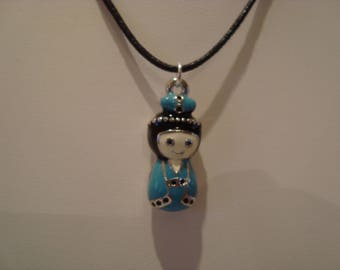 Blue and black doll pendant necklace