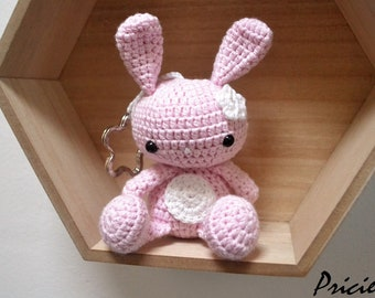Amigurumi Kawaii rabbit with pink crochet hook