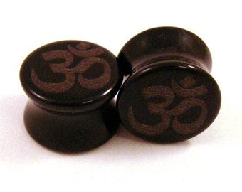 "Om Symbol Black Glass Plugs - 2g (6mm) 00g (10mm) 7/16"" (11mm) 9/16"" (14mm) Ohm Opaque Gauges"