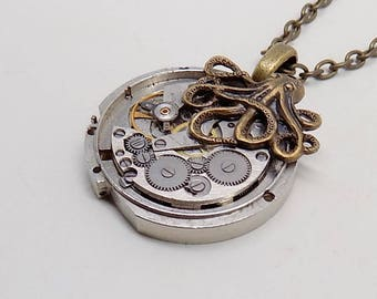 Steampunk jewelry. Steampunk octopus pendant necklace on a vintage watch.