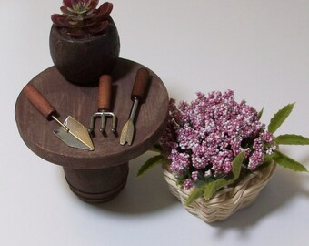 Fairy or gnome Garden miniature wood table with flower basket and gardening tools