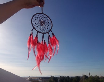 Handmade dreamcatcher brown with red feathers. 12cm diameter