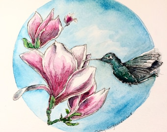 Magnolia flowers and hummingbird