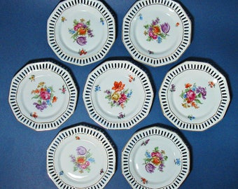 Set of Seven Schumann Bavaria Petite Plates with Floral Patterns and Pierced Rims