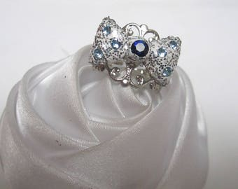 ring Crystal bow tie and blue rhinestones