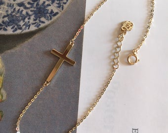14k yellow gold sideway cross bracelet