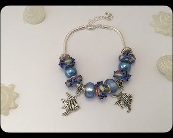 Blue charm's bracelet with fish theme holiday ref 552