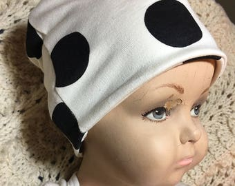 Black Dots on White Organic Slouch Cap Hat. Cool organic cotton hat in sizes preemie to 6 years. Double-sided and can be folded up.