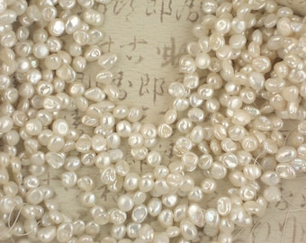 "Iridescent White Keishi Pearls Plump Top Drilled 15"" strand (4130)"