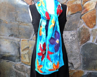 Wide nuno felt scarf: large tropical flowers on turquoise blue dyed silk