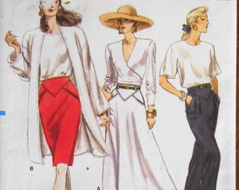 Vogue 7132.  Vintage skirt and pants pattern.  Straight skirt pattern.  Flared skirt pattern.  Straight leg pants pattern.  Sizes 14-18.