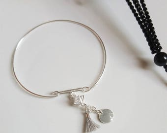 The Bangle is silver gray tassel and pendant DIY kit
