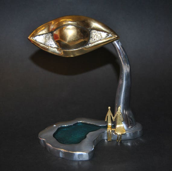 Decoration item, handmade. Aluminum eyedrop and brass figures. The color is made of glass.