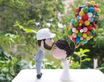 Cute couple kiss with ballons. Wedding cake topper. Wedding figurine. Bride and Groom. Handmade. Fully customizable. Unique keepsake