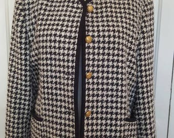 Classic Chanel style vintage black and white houndstooth wool boucle jacket.