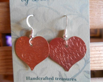 Heart earrings in hammered copper with sterling silver wires.