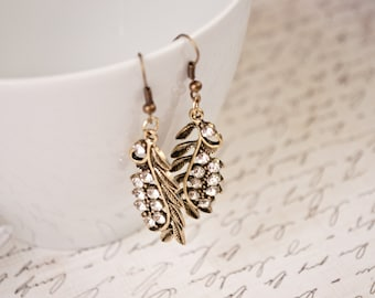 Gold Tone Feather Earrings with Swarovski accents