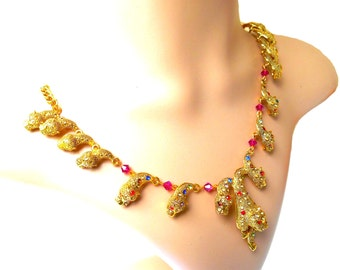 Tiger Puma gold necklace of wealth and spinning tops swarovski