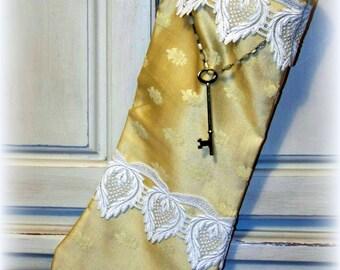 Gold brocade Christmas Stocking, cream lace, rosary beads, brass key