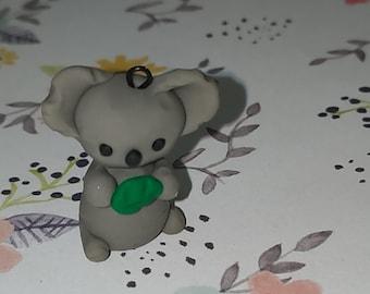 Koala clay charms holding a leaf