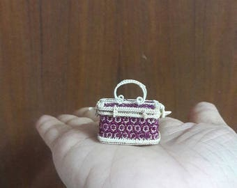 tiny wicker basket  used to be made of rattand bamboo.they are from Bangkok Thailand