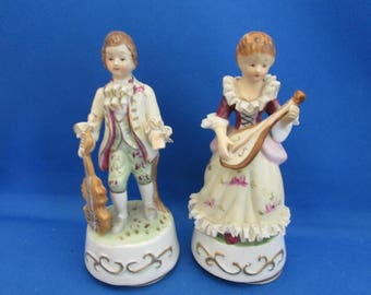 Two Colonial Musical Figurines
