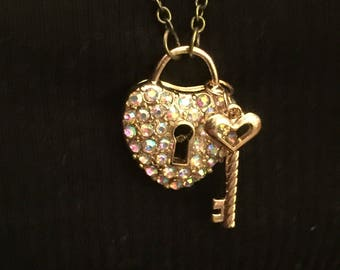 Gold heart lock and key charm necklace