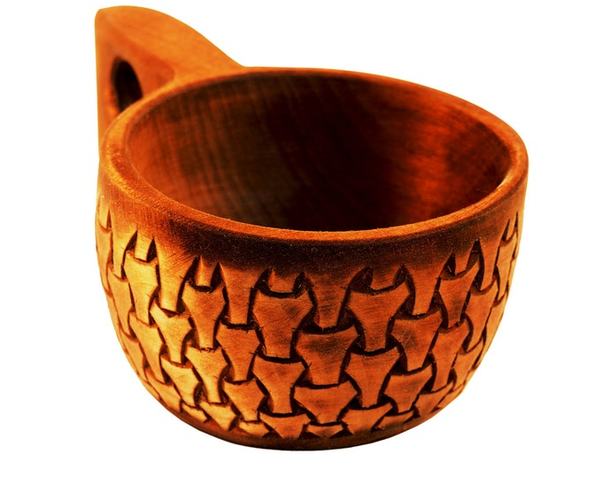 Intricately carved wooden cup borre style