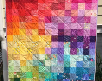 Lap-sized patchwork quilt in rainbow colors, baby rainbow blanket
