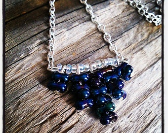 blue butterfly beads and silver necklace
