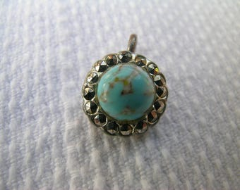 A unique upcycled vintage mid century faux turquoise and marcasite silver tone pendant