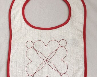 Bib with 4 Tesselated Hearts Embroidery & red edging, snap closure