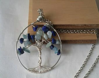 Tree of life with aquamarine and lapis lazui chips with a Herkimer diamond quartz in the center.