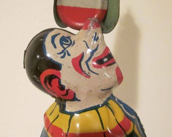 Early Chein Tin Litho Clown with Umbrella or Fan Wind Up Toy