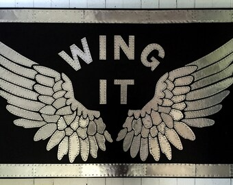 WING IT -  Metal Assemblage on Wood