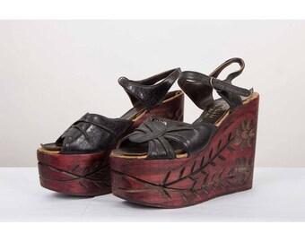 Vintage platforms / 1970s Carved wood sky high leather monster platform shoes / Open toe and ankle strap  8.5