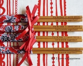 Personalised engraved chopsticks and sleeves with ribbons