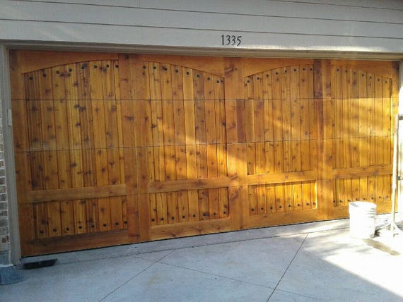Solid wooden garage door get custom design or size - Custom size garage doors ...