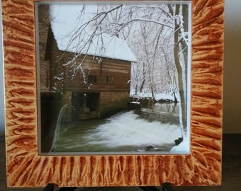 Shadowbox frame vinegar painted in coppery sienna