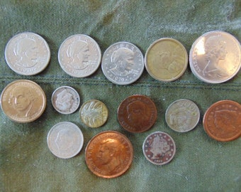 Lot of 14 coins including 1912 US nickel and 1851 US One cent.